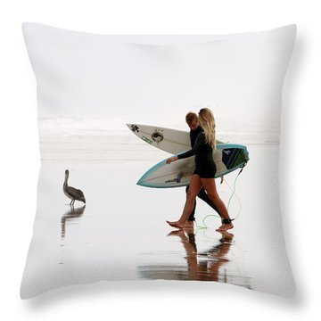Throw Pillow featuring the photograph Surfers And A Pelican by Alice Gipson