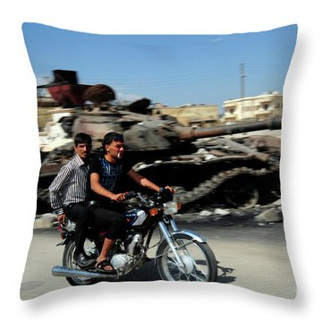 Syrian Men Drive A Motorbike Throw Pillow by Andrew Chittock