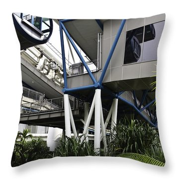 The Area Below The Capsules Of The Singapore Flyer Throw Pillow by Ashish Agarwal