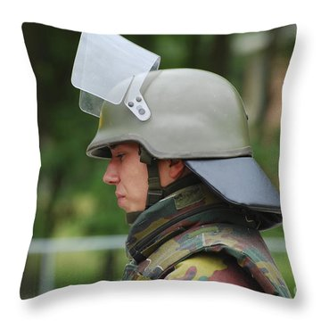 The Helmet And Visor Used Throw Pillow by Luc De Jaeger