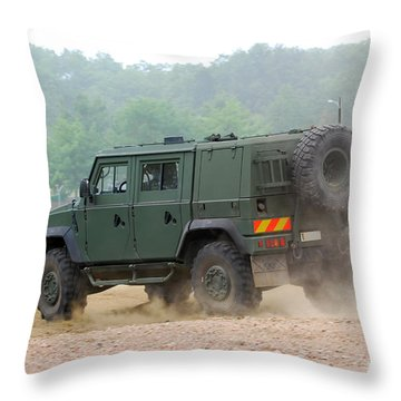 The Iveco Light Multirole Vehicle Throw Pillow by Luc De Jaeger