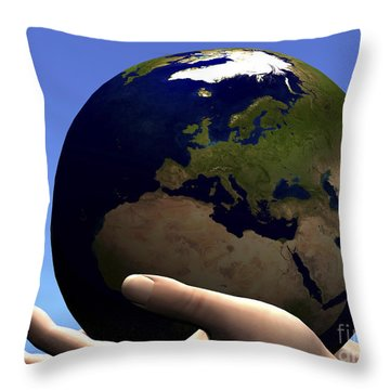 The Planet Earth Is Held In Caring Throw Pillow by Corey Ford