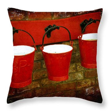Three Red Buckets Throw Pillow by Svetlana Sewell