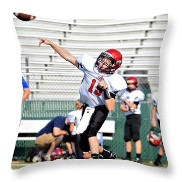 Throwing A Pass Throw Pillow by Susan Leggett