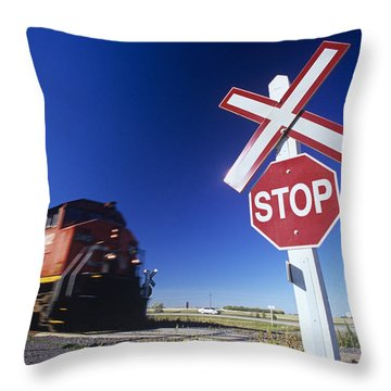 Train Passing Railway Crossing Throw Pillow by Dave Reede