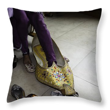 Throw Pillow featuring the photograph Trying On A Very Large Decorated Shoe by Ashish Agarwal