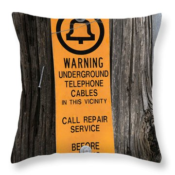 Underground Telephone Cable Sign Throw Pillow by Photo Researchers