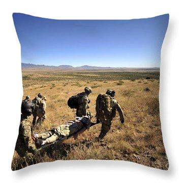 U.s. Air Force Pararescuemen Carry Throw Pillow by Stocktrek Images