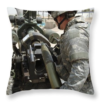 U.s. Army Soldier Loads A 105mm Throw Pillow by Stocktrek Images