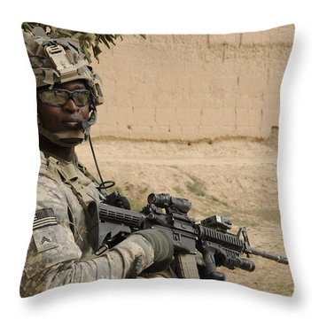 U.s. Army Soldier Scans His Area While Throw Pillow by Stocktrek Images