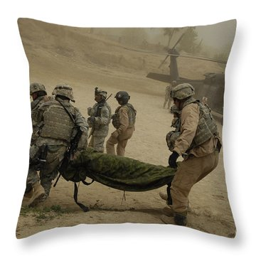 U.s. Army Soldiers Medically Evacuate Throw Pillow by Stocktrek Images