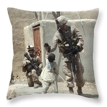 U.s. Marine Gives An Afghan Child Throw Pillow by Stocktrek Images