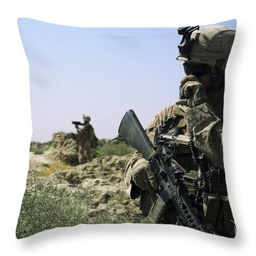 U.s. Marine Uses A Radio Throw Pillow by Stocktrek Images