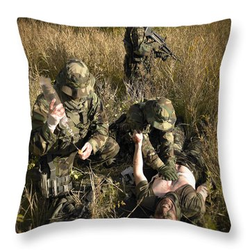 U.s. Navy Seals Give First Aid Throw Pillow by Tom Weber