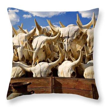 Wagon Full Of Animal Skulls Throw Pillow by Garry Gay