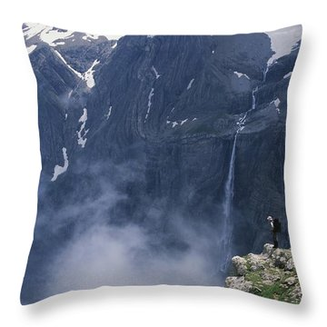 Walker Looking Over Waterfall At Cirque Throw Pillow