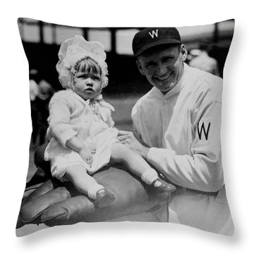 Throw Pillow featuring the photograph Walter Johnson Holding A Baby - C 1924 by International  Images