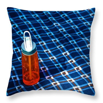 Water Bottle On A Blanket Throw Pillow by Eric Tressler