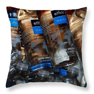 Water Bottles Throw Pillow by Rob Hans