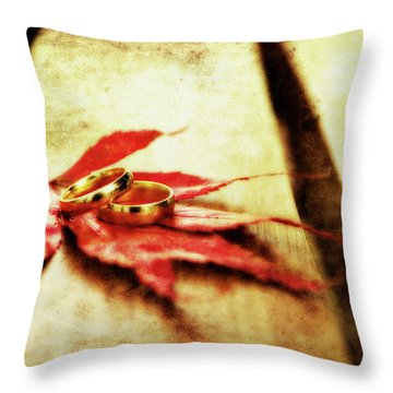 Wedding Rings On Red Throw Pillow by Meirion Matthias