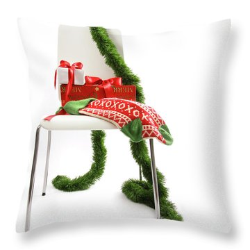 White Chair With Gifts And Garland On White  Throw Pillow by Sandra Cunningham