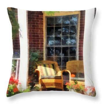 Wicker Chair With Striped Pillow Throw Pillow by Susan Savad