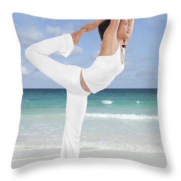 Woman Doing Yoga On The Beach Throw Pillow by Setsiri Silapasuwanchai