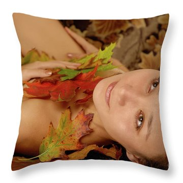Woman In Fallen Leaves Throw Pillow by Oleksiy Maksymenko