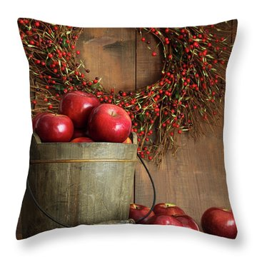 Wood Bucket Of Apples For The Holidays Throw Pillow by Sandra Cunningham
