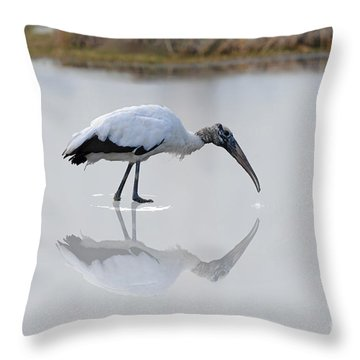 Throw Pillow featuring the photograph Wood Stork Eating by Dan Friend