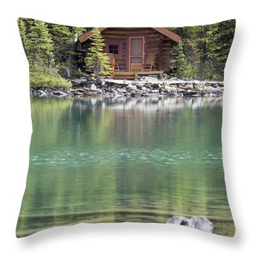 Wooden Cabin Along A Lake Shore Throw Pillow by Michael Interisano