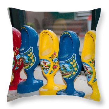 Throw Pillow featuring the digital art Wooden Shoes by Carol Ailles