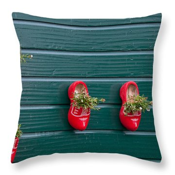 Throw Pillow featuring the digital art Wooden Shoes On Teh Wall by Carol Ailles