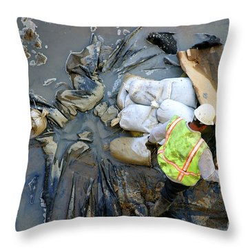 Working The Mud Throw Pillow by Henrik Lehnerer