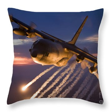 Throw Pillow featuring the photograph A C-130 Hercules Releases Flares by HIGH-G Productions