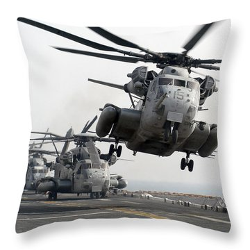 A Ch-53e Super Stallion Lifts Throw Pillow by Stocktrek Images