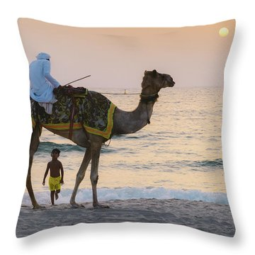 Little Boy Stares In Amazement At A Camel Riding On Marina Beach In Dubai, United Arab Emirates -  Throw Pillow