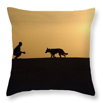 A Military Working Dog And His Handler Throw Pillow by Stocktrek Images