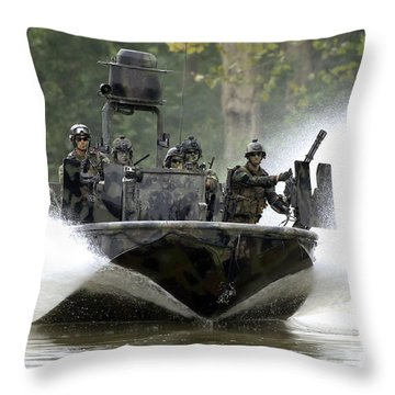 Throw Pillow featuring the photograph A Special Operations Craft Riverine by Stocktrek Images