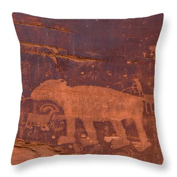 Throw Pillow featuring the photograph Ancient Native American Petroglyphs On A Canyon Wall Near Moab. by Jim Thompson