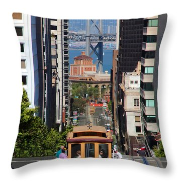 California Street Cable Car And The Bay Bridge Throw Pillow by Wernher Krutein