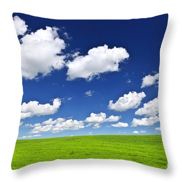 Green Rolling Hills Under Blue Sky Throw Pillow