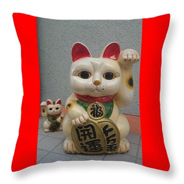 A Figure Of A Beckoning Cat, Called 'manekineko' Throw Pillow