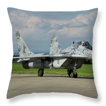 Throw Pillow featuring the photograph Mikoyan-gurevich Mig-29as by Tim Beach
