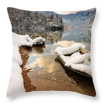 Snow Covered Boat On Lake Bohinj In Winter Throw Pillow