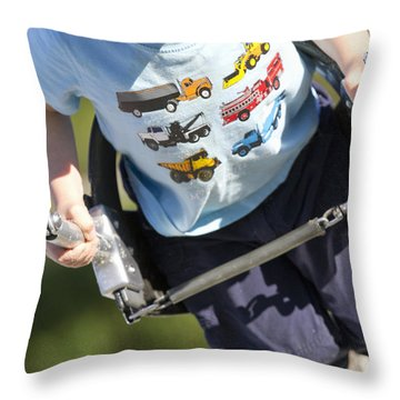 Young Boy Smiling Swinging In A Swing Throw Pillow by Robert Postma