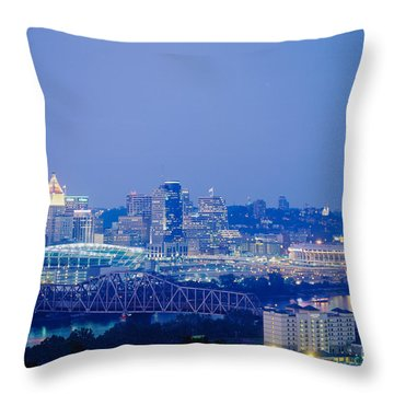 Buildings In A City Lit Up At Dusk Throw Pillow