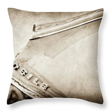 Throw Pillow featuring the photograph 1962 Oldsmobile Hood Ornament And Emblem -0598s by Jill Reger