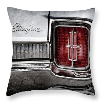 Throw Pillow featuring the photograph 1965 Oldsmobile Starfire Taillight Emblem -0212ac by Jill Reger