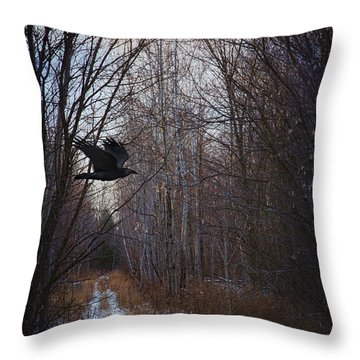 Black Bird Flying By In Forest Throw Pillow